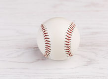 Baseball on wooden background Royalty Free Stock Photo