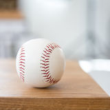 Baseball on wooden seat. Closeup Royalty Free Stock Images