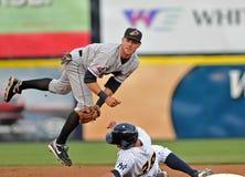 baseballa liga mniejszościowy kręcenie dwa obrazy royalty free