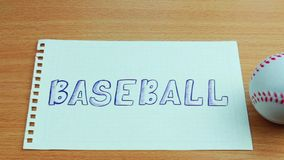 Baseballboll med en text lager videofilmer