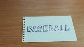 Baseballbollen glider på en inskrift stock video