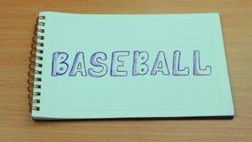 Baseballinskrift och boll arkivfilmer