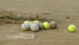 Baseballs. A collection of baseballs at home plate Royalty Free Stock Photography