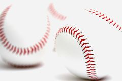 Baseballs. Close-up on white with two in back out of focus Royalty Free Stock Photos