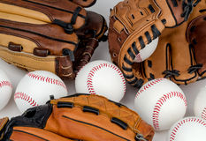 Baseballs and Baseball Gloves. A collection of Practice Baseballs, and Baseball Gloves Stock Photo