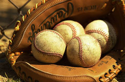 Baseballs in catcher glove. Royalty Free Stock Photos