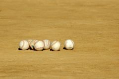 Baseballs in the Dirt at Pract. Loose baseballs strewn in the infield dirt during little league baseball practice Stock Photography