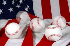 Baseballs and flag. Five baseballs on American flag with three double exposed Royalty Free Stock Photo