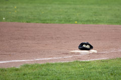 Baseballs in glove on playing field Stock Image