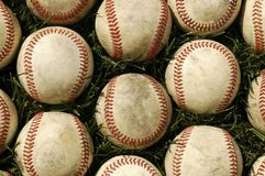Baseballs on grass Stock Photo