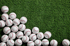 Baseballs on a green turf background. Several baseballs on a green turf background viewed from above stock photos