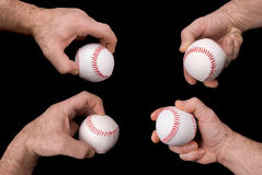 Baseballs in hands Stock Photo
