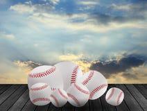Baseballs on wood with sky background. Stock Photo
