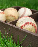 Baseballs in a wooden box Stock Image