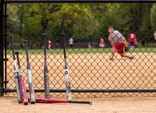 Baseballschläger und Spieler. Stockfotografie