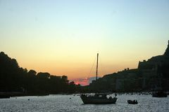 Baseboats in front of Portovenere at sunset royalty free stock photos