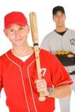 Basebol: Jogador que guarda o bastão de beisebol fotografia de stock