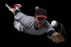 Basebollspelare på en röd likformig. Royaltyfri Fotografi