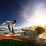 Basebollspelare två i handling Royaltyfri Bild
