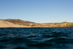 Basecamp. The surfers campground as viewed from the water Royalty Free Stock Images