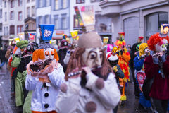 Basel carnival 2017. Gerbergasse, Basel, Switzerland - March 6, 2017. Close-up of a group of carnival participants in their individual costumes and masks playing Stock Photos