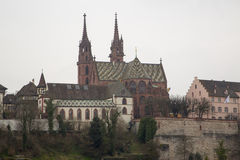 The Basel Cathedral on a Cloudy Day Stock Photos