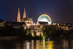 Basel Minster over the Rhine by night - Switzerland Stock Photography