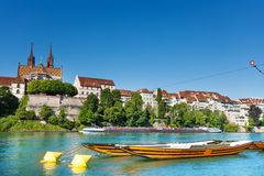 Boats on the river Rhine in Basel, Switzerland. Basel Munster and boats on the river Rhine, Switzerland Royalty Free Stock Images