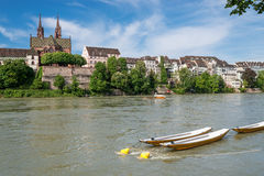 Basel With Rhine River. Tanquil scene on the Rhine boarder with a nice view up to the Basel cathedral Royalty Free Stock Images