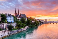 Basel, Switzerland. Old town with Munster cathedral on the Rhine river at sunset stock image