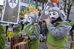 Basel (Switzerland) - Carnival 2016. Some fully costumed carnival activists walk through the city during the carnival procession (cortege) of the Carnivel at Stock Photos