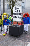 Basel (Switzerland) - Carnival 2016. Some fully costumed carnival activists walk through the city during the carnival procession (cortege) of the Carnivel at Royalty Free Stock Photo