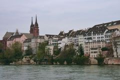 Basel, Switzerland. Basel Cathedral and houses along river rhine Royalty Free Stock Photo