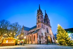 Basel, Swizterland - Munster Cathedral and Christmas Market. Basel, Switzerland. Christmas fairytale market at Munsterplatz and Munster Cathedral, Swiss Stock Photos