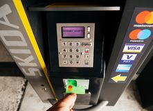 Male hand taking card out of parking machine royalty free stock images