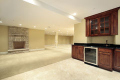 Basement with bar and fireplace. Basement in new construction home with bar and fireplace Royalty Free Stock Photos