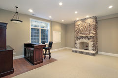 Basement with brick fireplace Stock Images