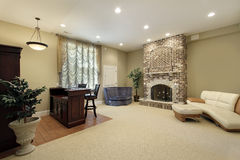 Basement with brick fireplace Royalty Free Stock Images