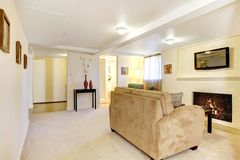 Basement bright living room with fireplace. Stock Photography