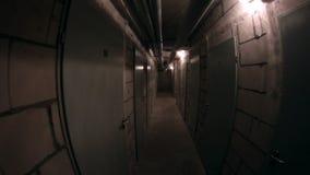 Basement corridor walking. Dynamic shot of walking in basement corridor with handheld camera and fish-eye lens stock video