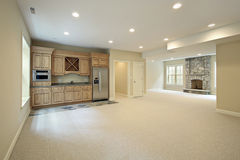 Basement with fireplace and bar. Basement of new construction home with fireplace Royalty Free Stock Photos