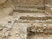 Basement and floor of historic Greek house. Excavation of the former historic city of Empúries (Latin: Emporium), inhabited by the ancients Greeks and Romans ( Royalty Free Stock Photography