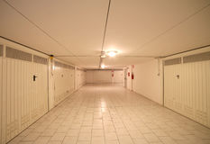 Basement garage in an underground parking lot of the apartment b Royalty Free Stock Image