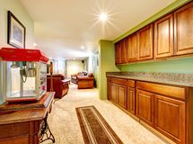 Basement interior with cabinets and green walls. Royalty Free Stock Image