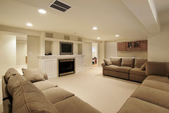 Basement in luxury home. With white fireplace Stock Image