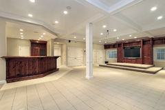 Basement in luxury home. With step up TV area Stock Photography