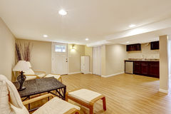 Basement mother-in-law apartment. Living room and kitchen area Stock Image