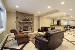 Basement in new construction home. With stone fireplace Stock Photo