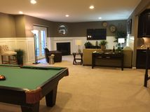 Basement with pool table. Beautifully designed basement with pool table and fireplace Stock Photo