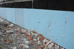 Basement rigid insulation details with damp proofing. House foundation insulation for energy saving. Photo royalty free stock photo